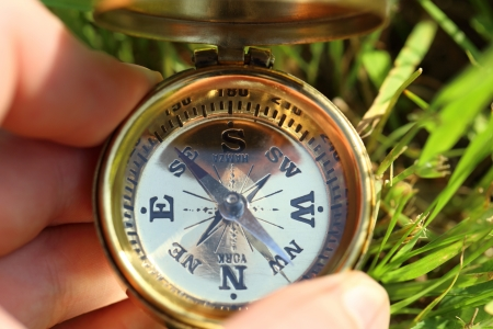 Golden compass in male hand photo