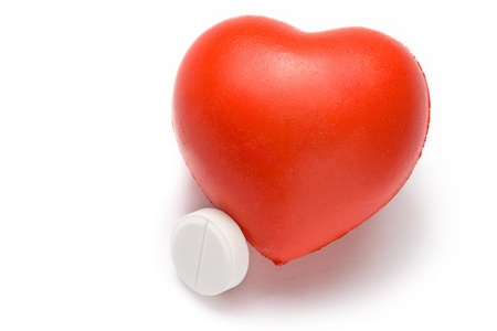 Heart and pill on the white background photo