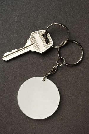Key isolated on the dark background photo