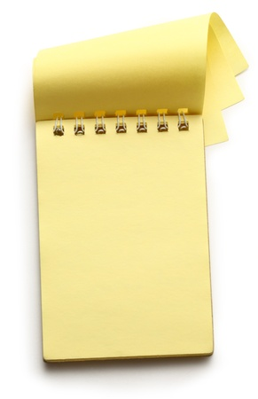 yellow notepad: Open yellow notepad on white