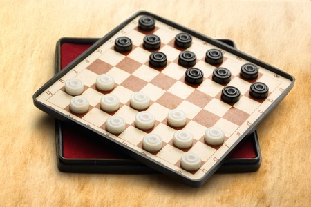 draughts: Travelling draughts on aged background