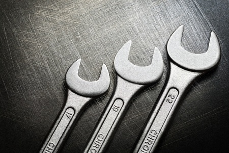 scratchy: Spanner on steel scratchy background
