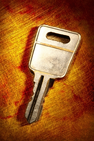 Metal key on iron background photo