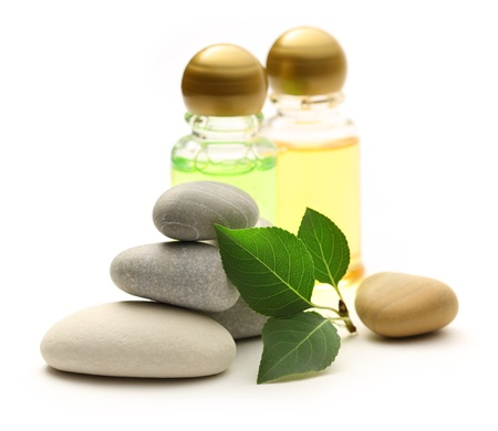 oriental massage: Stones, leaves and shampoo bottles Stock Photo