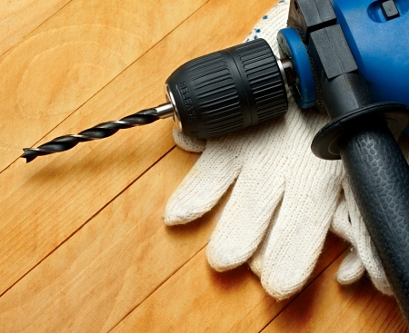 hand drill: Hand drill and protective gloves