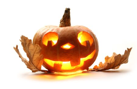 Funny halloween pumpkin with oak leaves photo