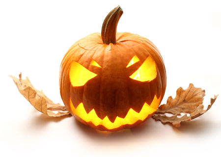 Angry halloween pumpkin with oak leaves photo