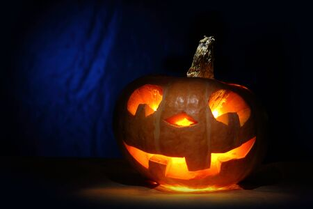 Funny halloween pumpkin in blue Stock Photo
