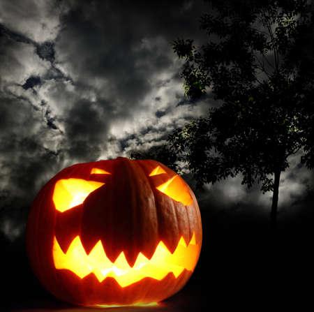 Angry halloween pumpkin on thunder sky background photo