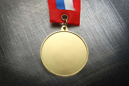 scratchy: Metal medal with tricolor ribbon on steel scratchy