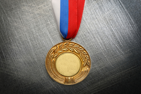 Metal medal with tricolor ribbon on steel scratchy  photo