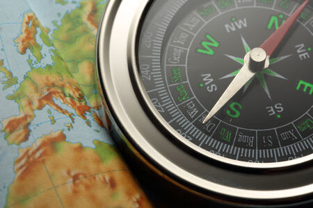 Compass on Earth map background photo