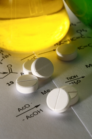 Chemistry reaction formula with white pills photo