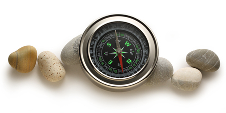magnetic stones: Compass and sea stones on white
