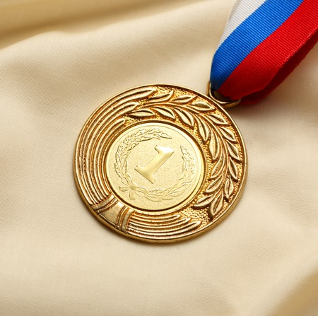 Metal medal on silk wrinkled cloth photo
