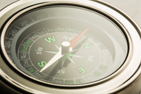 azimuth: Compass closeup in light toning