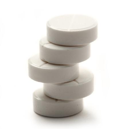 Aspirin pills on white