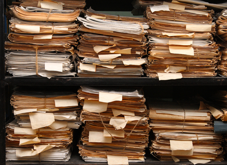 Paper documents stacked in archive Standard-Bild