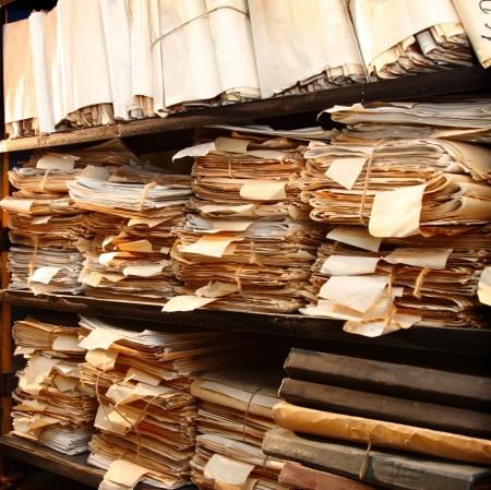 Paper documents stacked in archive Archivio Fotografico