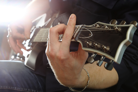 Electric guitar in male hands photo