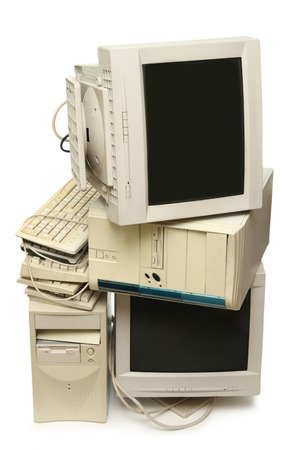 Heap of used computers and monitors