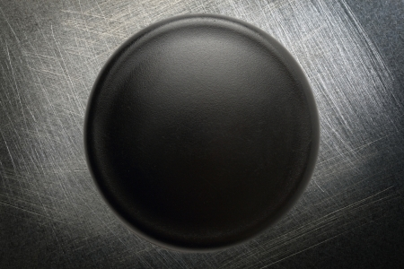 scratchy: Black button on steel scratchy