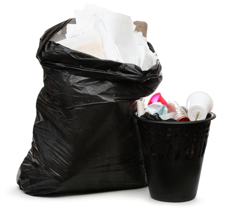 wastebasket: Full black wastebasket and plastic bag Stock Photo