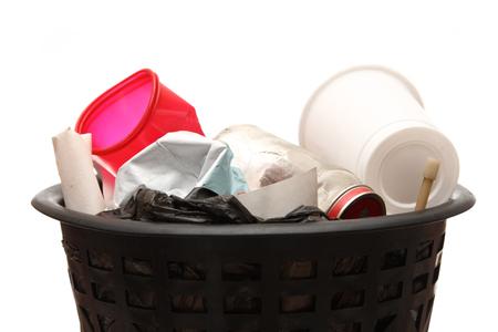 wastebasket: Full black wastebasket on white Stock Photo