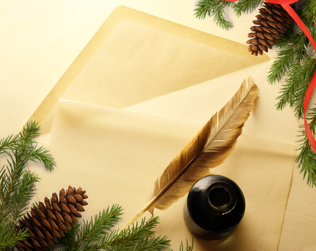 Christmas decoration on envelope with inkwell and feather photo