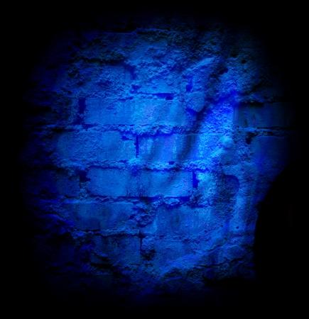 sheetrock: Blue brick stone wall with damaged sheetrock