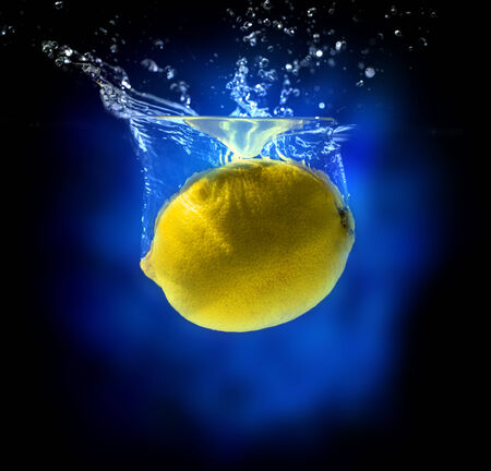 Yellow lemon in water splash photo