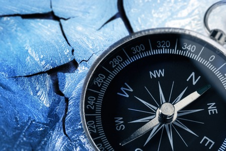 magnetic stones: Compass on racked piece of old wall in icy style