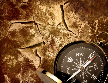 magnetic stones: Compass on cracked piece of old wall Stock Photo