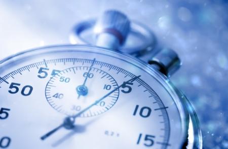 Stopwatch on snow in blue toning Standard-Bild