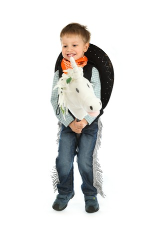 Cowboy child riding white unicorn photo