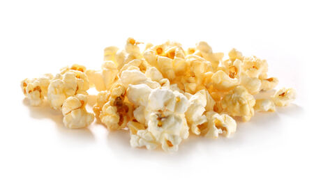 Sweet popcorn in closeup on white photo
