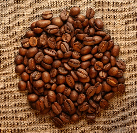 Brown coffee beans on sack photo