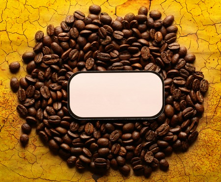 Brown coffee beans with blank label photo