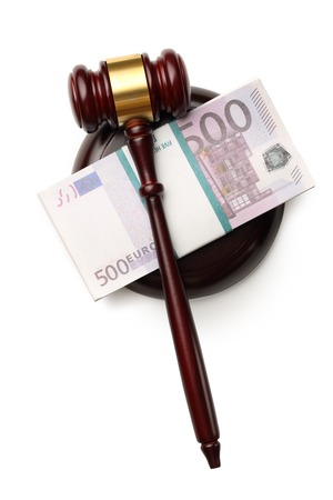 Wooden judges gavel and money photo