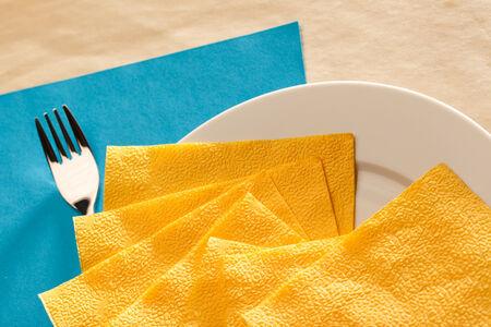serviette: Plate, fork and yellow serviette