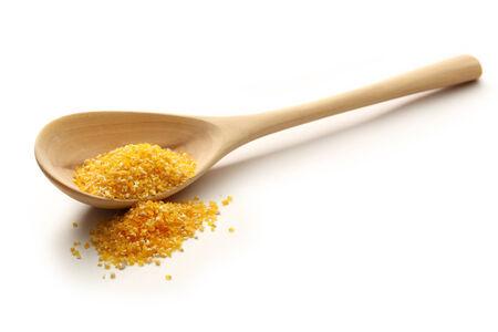 splintered: Yellow splintered corn in wooden spoon