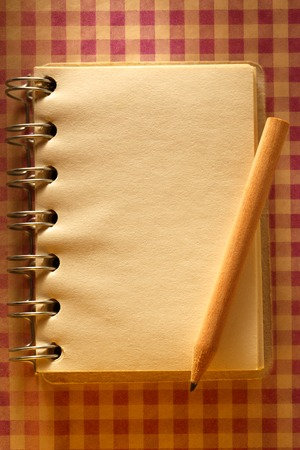 Blank open notepad with wooden pencil photo