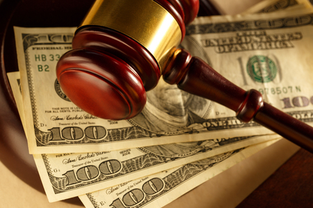 tax law: Wooden gavel and dollar banknotes Stock Photo