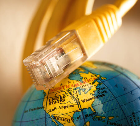 Ethernet cable for computer and globe photo