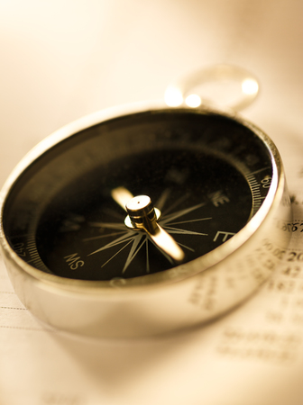 Operating budget and black compass in toning photo