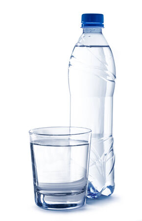 Plastic bottle and glass of water photo