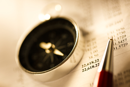 Budget, compass and pen in toning photo