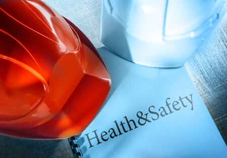 health industry: Health and safety with red and white helmets