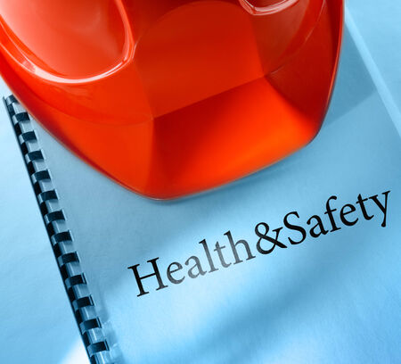 health industry: Health and safety with red helmet Stock Photo