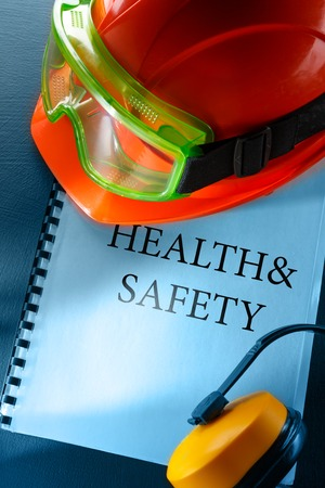 Safety goggles, earphones and red helmet